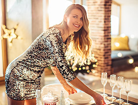 attractive woman setting up party